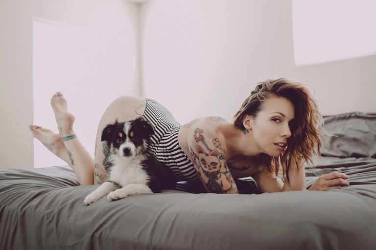 Las Vegas Boudoir Photography. Sexy pictures taking in bed with puppy.  Tattooed boudoir photography photo session.